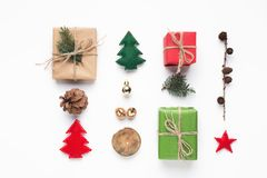 Minimalistic Christmas composition with decorations on white Stock Photography
