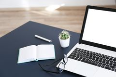 Minimalistic composition of workplace with laptop and stationery royalty free stock photos