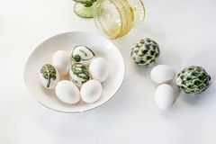 Minimalistic Easter eggs decorated with decoupage and white on a white background. Simple decoration of eggs with children royalty free stock images