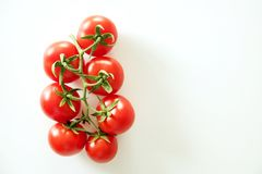 Free Minimalistic Flat Lay Composition Of Shiny Red Cherry Tomatoes Reflecting Light, Laying On Solid White Table Top. Royalty Free Stock Image - 112315126