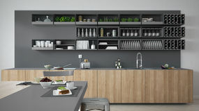 Minimalistic gray kitchen with wooden and gray details, vegetari Stock Photo