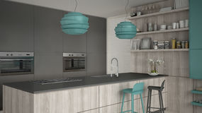 Minimalistic gray kitchen with wooden and turquoise details, min Stock Images