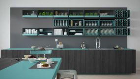 Minimalistic gray kitchen with wooden and turquoise details, veg Stock Image