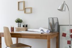 Minimalistic home office. With modern wooden furniture Royalty Free Stock Photos