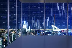 Trade and stats concept. Minimalistic interior with night New York city view and forex chart on windows. Trade and stats concept. Double exposure stock photography