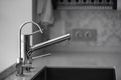 Minimalistic kitchen corner with appliances. Water tap in the kitchen stock images