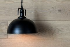 A minimalistic lighting element in the interior. Lamp made of metal. Royalty Free Stock Photo