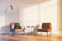 Minimalistic living room, beige armchairs toned. Minimalistic living room interior with white walls, a wooden floor, two leather armchairs and a tiny coffee Royalty Free Stock Photo