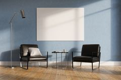 Minimalistic living room, black armchairs. Minimalistic living room interior with blue walls, a wooden floor, two leather armchairs and a tiny coffee table. A Stock Images