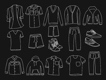 MInimalistic Men clothes and shoes illustrations icons, thin line style on the black background Royalty Free Stock Photography
