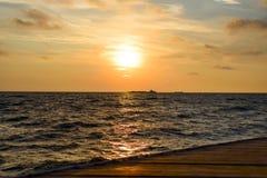 Minimalistic orange sunrise over the ocean with waves near the shore. Minimalistic orange sunrise over ocean with waves near the shore royalty free stock photography