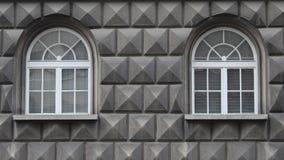 Minimalistic facade photo containing two windows. Minimalistic photo of the building facade containing two white windows. Symetrical photo Stock Image