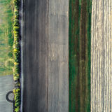 Minimalistic photograph of the beveled field, taken from the air. Stock Images