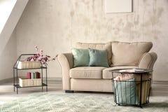 Minimalistic room interior with cozy sofa royalty free stock image