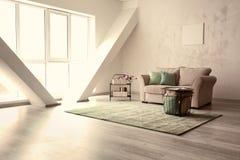Minimalistic room interior with cozy sofa royalty free stock photo