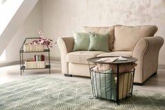 Minimalistic room interior with cozy sofa royalty free stock photos