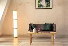 Minimalistic room interior with cozy sofa and table royalty free stock photography