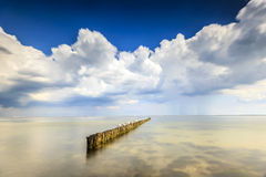 Minimalistic Seascape. Means Water, Breakwater and Sky Stock Images