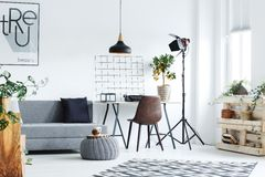 Minimalistic studio flat. Decorated with creative accessories stock photo