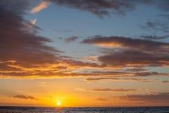 Minimalistic sunset landscape - sun, clouds, and sea. Stock Photos