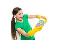 A minimum effort on cleaning the house. Small housekeeper holding dish sponges in rubber gloves. Cleaning and washing up. Small housemaid ready for household royalty free stock photo