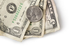 Minimum Wage - Quarter on top. Wrinkled dollar bills and a quarter adding up to $7.25, the current (as of 2016) U.S. Federal Minimum wage Royalty Free Stock Photos
