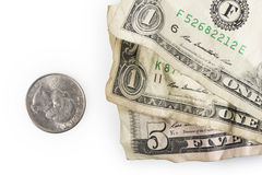 Minimum Wage. Wrinkled dollar bills and a quarter adding up to $7.25, the current (as of 2016) U.S. Federal Minimum wage Royalty Free Stock Photos