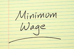 Minimum Wage On A Yellow Legal Pad. The word `Minimum Wage` underlined on a yellow legal pad stock images