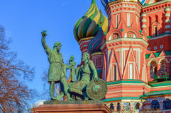 Minin and Pozharsky monument on Red square, Moscow. Monument to Minin and Pozharsky on Red square with St. Basil Blazhenny`s temple on the background, famous Stock Photo