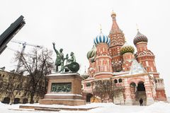 . Minin and Pozharsky Monument on Red square in Moscow. View of Monument Мinin with Pozharsky Vasily Blazhennogo's cathedral surrounding by snow in winter Stock Images