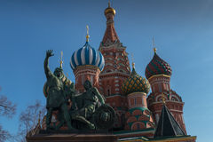 Minin and Pozharsky and temple. Statue of Kuzma Minin and Dmitry Pozharsky with Saint Basil's Cathedral on the background royalty free stock images