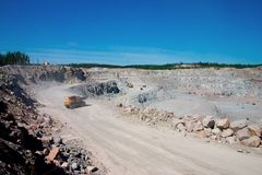 Mining 1. Mountain development, extraction of a granite. Road on edge career Royalty Free Stock Images