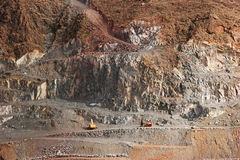 Mining. Heavy machines are developing rock Stock Photo