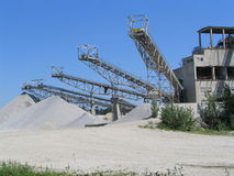 Mining. And transport towers for the sand and grit Stock Image
