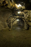 Mining adit and tunnel underground. A long mining tunnel underground Royalty Free Stock Images