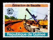 Mining, Bauxite mining, Boke serie, circa 1974. MOSCOW, RUSSIA - JANUARY 2, 2018: A stamp printed in Guinea shows Mining, Bauxite mining, Boke serie, circa 1974 Royalty Free Stock Photography