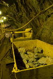 Mining car and tunnel underground. Mine car with ore in underground tunnel Royalty Free Stock Photography