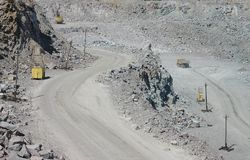 Mining in career. Mountain development, extraction of a granite. Road on edge career Stock Image