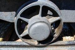 Mining cart on railway, macro photo to wheel stock images