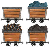 Mining carts with stones and bombs Royalty Free Stock Photography