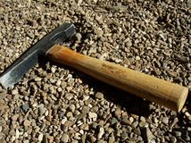 Mining Chisel Hammer. A chisel hammer lies in gravel after a hard days work Stock Photos