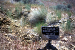 Mining Claim Sign. A sign indicating the site of a federal mining claim staked in the ground Stock Photo