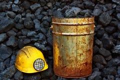 Mining coal. Bucket of coal and helmet coal miner Stock Photo