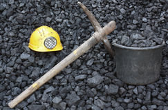 Mining coal. Mining tools on a background of coal Royalty Free Stock Images