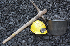 Mining coal. Mining tools on a background of coal Royalty Free Stock Photo