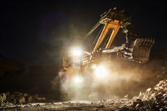 Mining construction industry. Excavator digging granite or ore in quarry Stock Photo