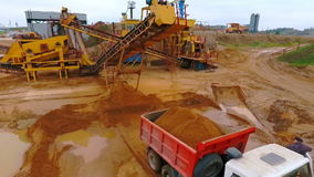 Mining conveyor pour sand in dumper truck. Sand mining. Mining machinery. Mining conveyor pour sand in dumper truck. Mining equipment working at sand mine stock video footage