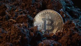 Mining crypto currency - Bitcoin. Online money coin in the dirt ground. Digital currency, block chain market, online business.  stock footage