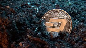 Mining crypto currency - Dash coin. Online money coin in the dirt ground. Digital currency, block chain market, online business.  stock video footage