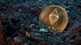 Mining crypto currency - Ethereum. Online money coin in the dirt ground. Digital currency, block chain market, online business.  stock video footage